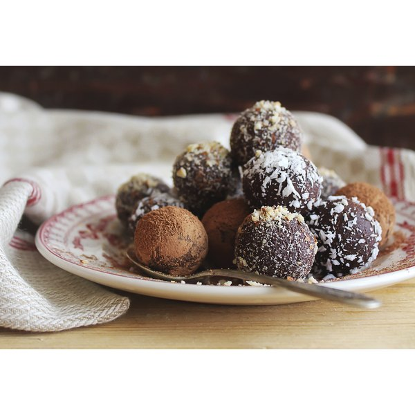 A decadent plate of chocolate truffles.