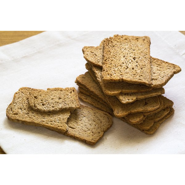 A stack of melba toast on a white plate.