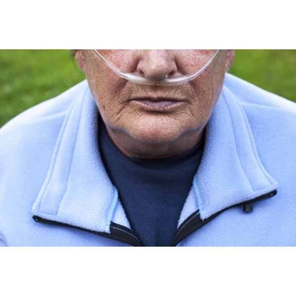 Senior man breathing with oxygen