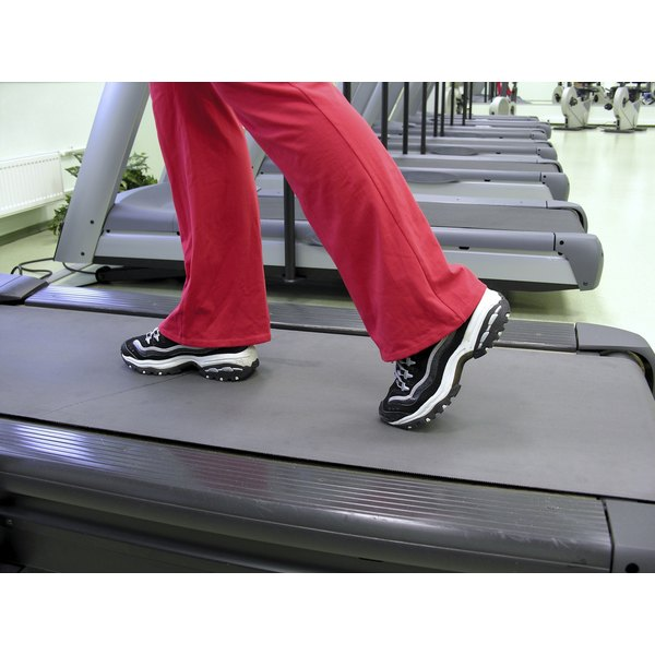 Close up of feet on a treadmill.