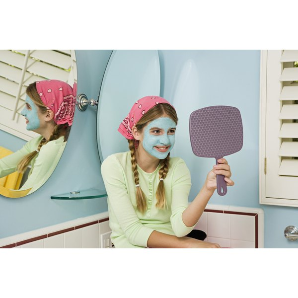 A young teen doing a home facial.