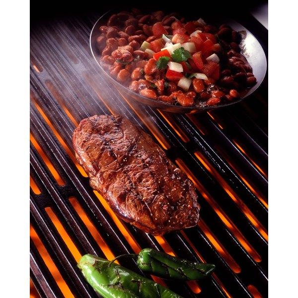 Ribeye steaks on grill.