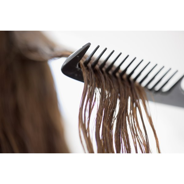 A fine-tooth comb easily smooths flyaways on the top layer of hair.