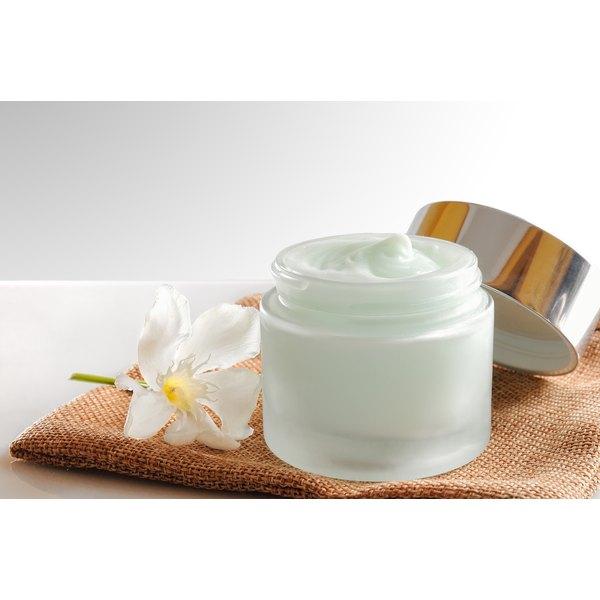 An open jar of face cream.