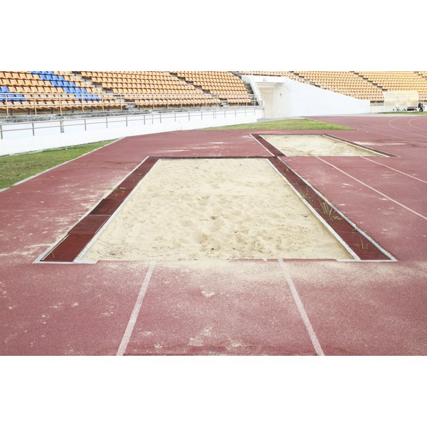 A long jump pit in a stadium.