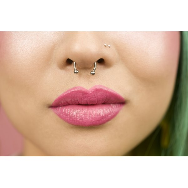 A woman with nose and nostril piercings.