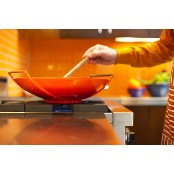 Keep the food moving in the wok so it cooks evenly.