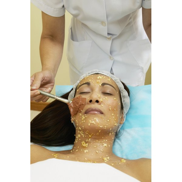 Woman receiveing a spa facial.