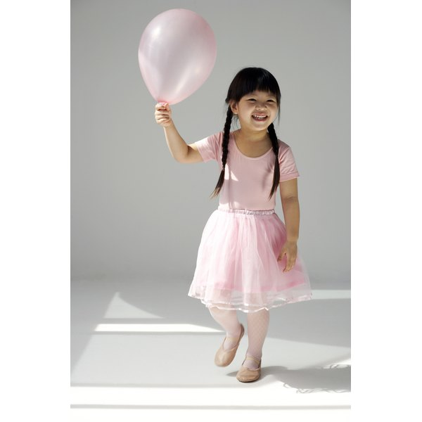 A balloon wall can provide decoration and entertainment at a birthday party.