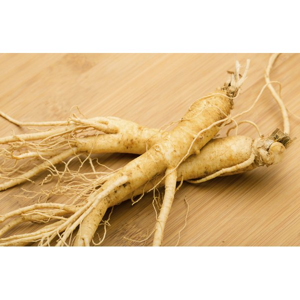 Ginseng roots on a wooden countertop.