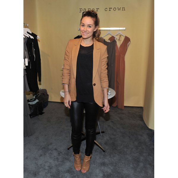 Lauren Conrad pairs her blazer with black leggings.