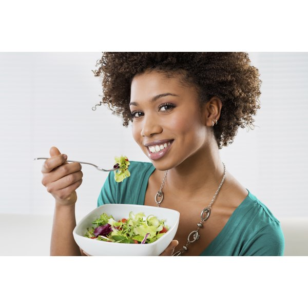 Woman eating a salad.