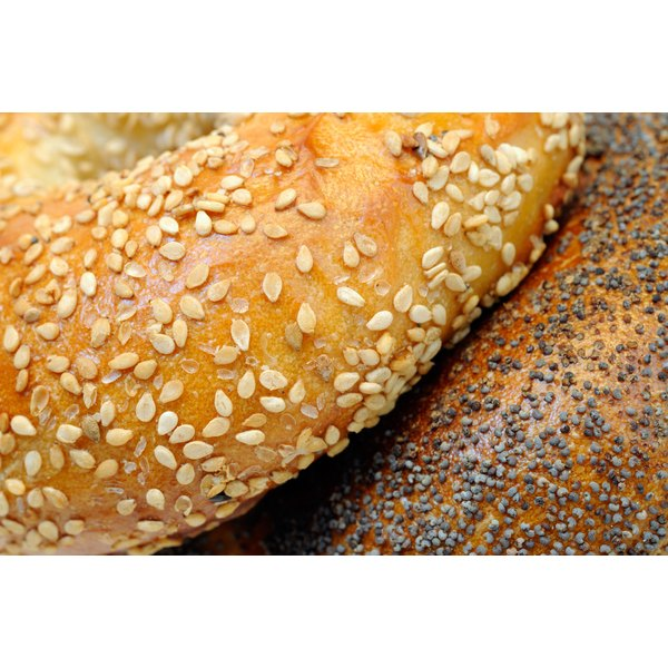 A close-up of poppy and sesame seed bagels.