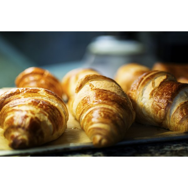 Close-up of croissants being toasted on pan.