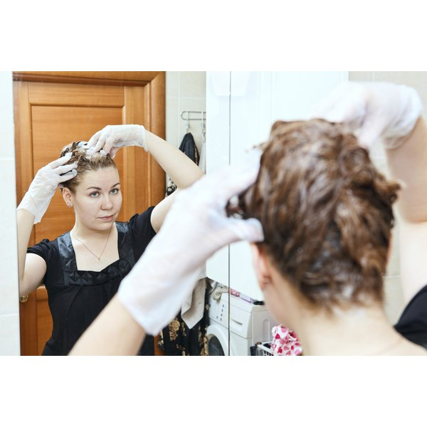 Woman coloring her hair at home.