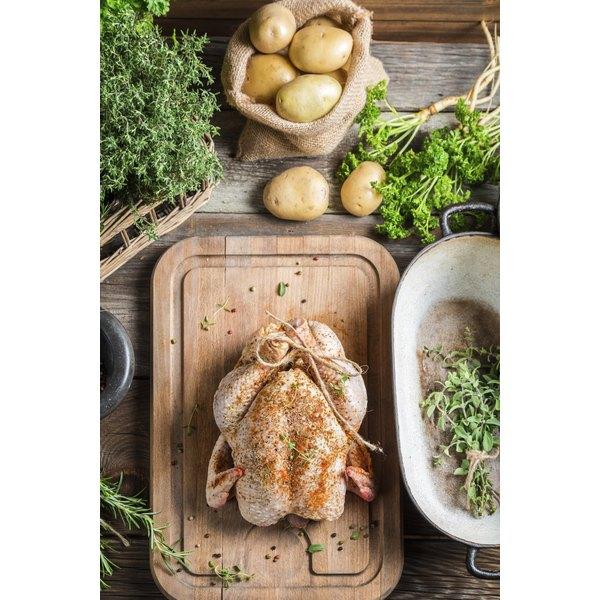 Prepped turkey on cutting board.