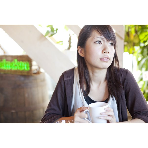 A young woman is drinking coffee.