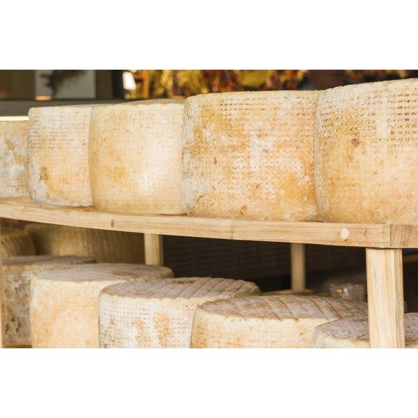 Asiago cheese on display at an Italian market.