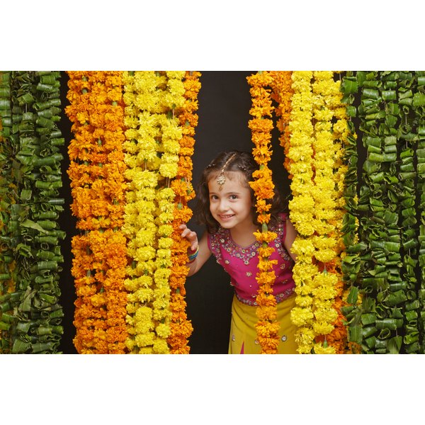 Make a garland from real or silk marigolds to decorate the home.