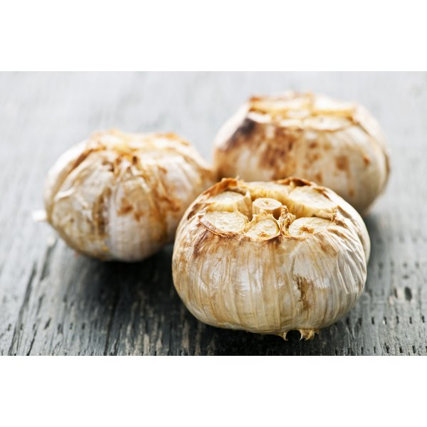 Fresh roasted garlic bulbs.
