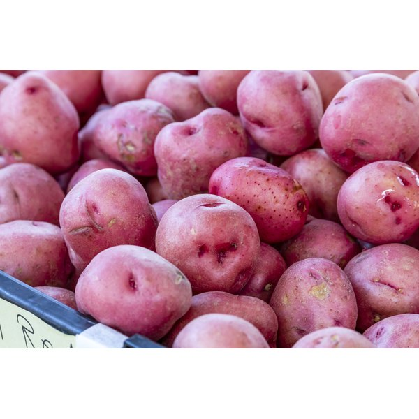 A large basket of red potatoes.