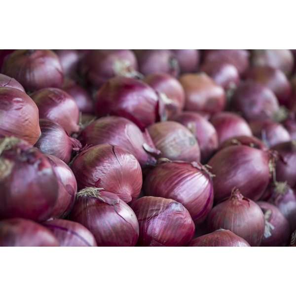 Red onions for sale at a market.