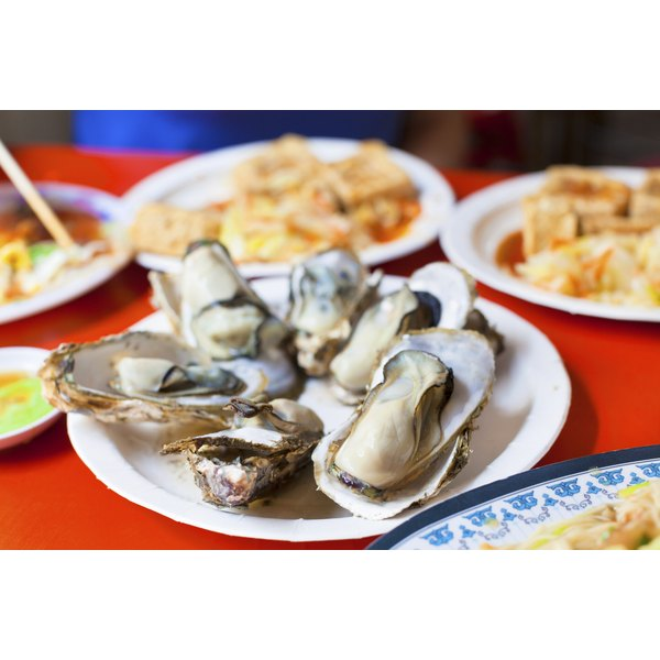 Barbecued oysters on a plate.