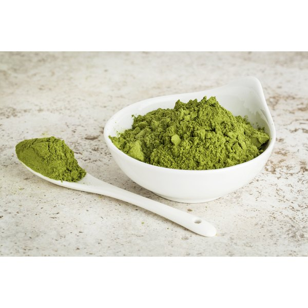 A small bowl of Moringa oleifera powder.