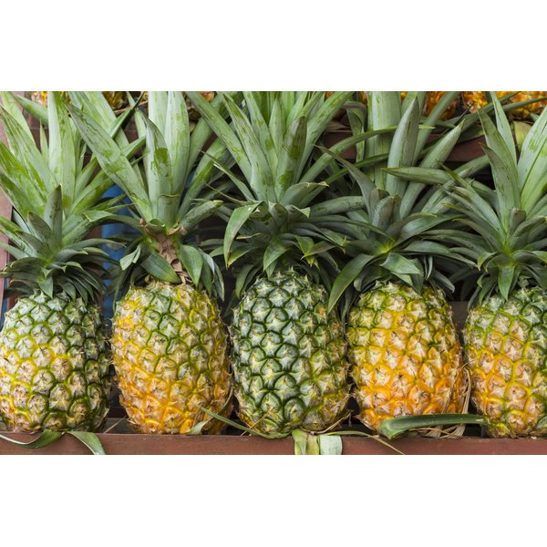 Pineapples for sale at a market.