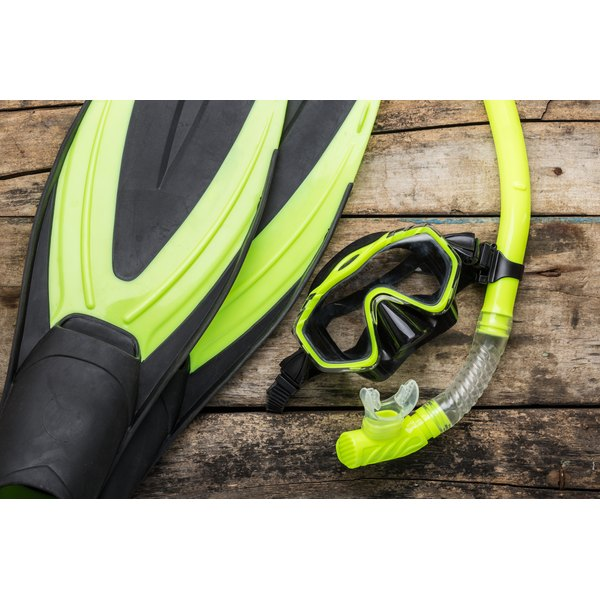 Snorkeling equipment on a wood background