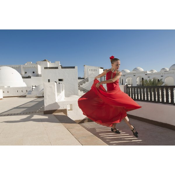 A female flamenco dancer in a traditional red dress.