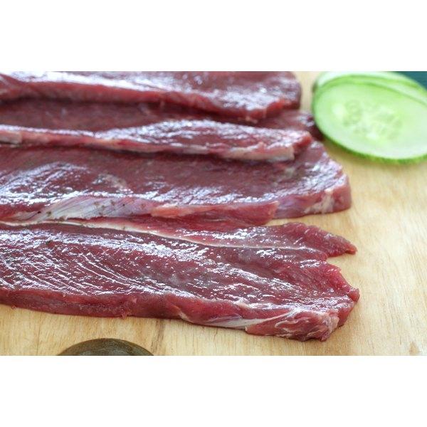 Preparing Sirloin Strip Steaks.