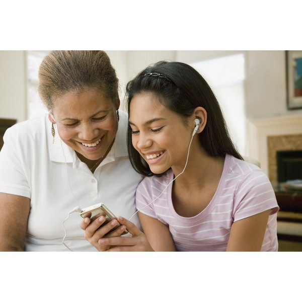 A mother and her daughter are listening to music together.