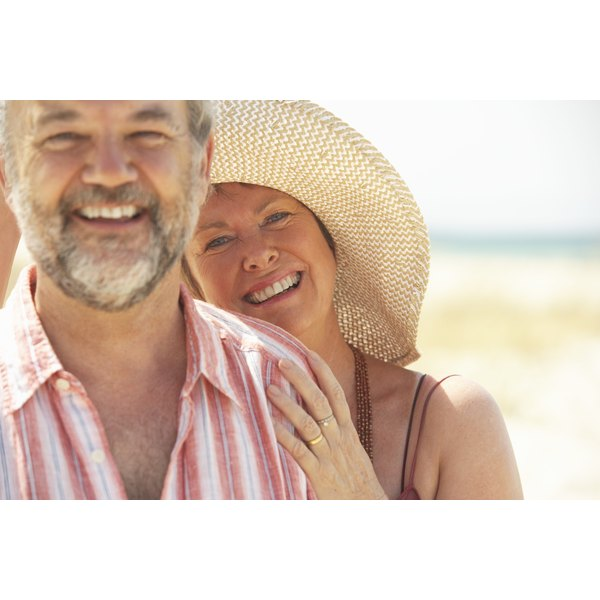 Mature couple, woman wearing hat to protect from sun.