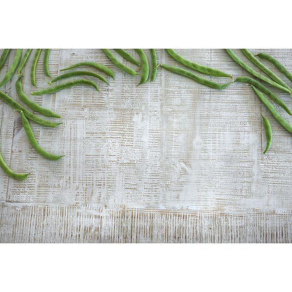 French green beans on a wooden table.