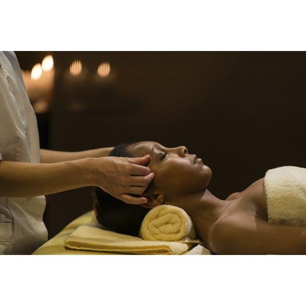 A woman receives a facial massage.