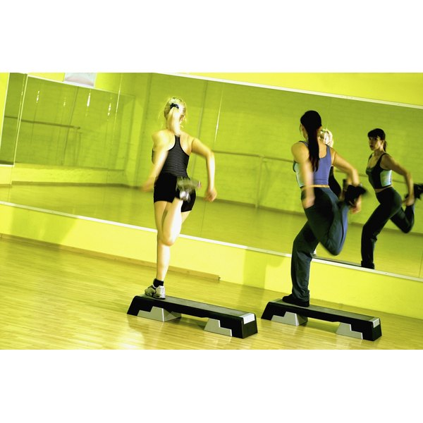 dynamic image of two women in high energy step class