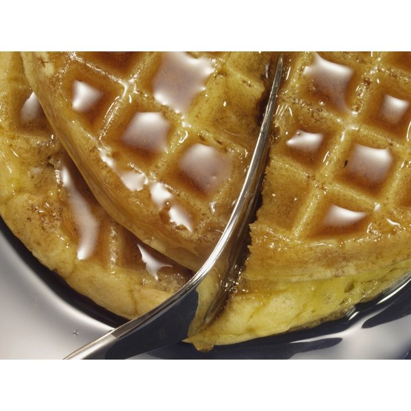 Waffles with syrup on them.