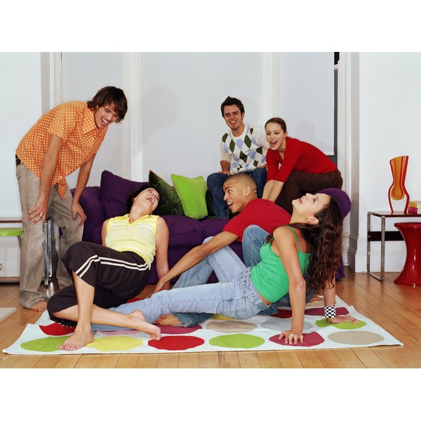 A group of friends play Twister.