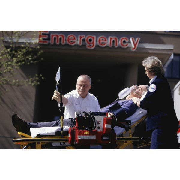Man on gurney going into emergency room