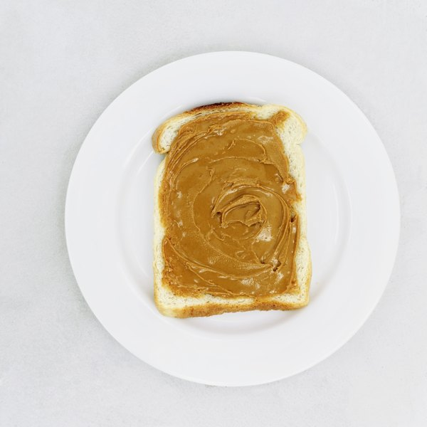 Peanut butter on a piece of toast.