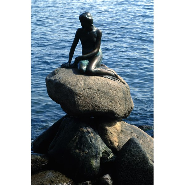 A statue of Hans Christian Andersen's mermaid sits in the harbor at Copenhagen.
