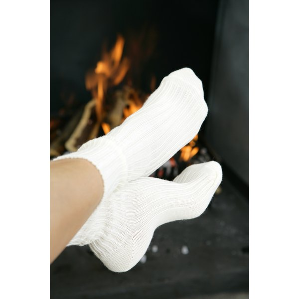 Before treating white socks for stains, evaluate whether they seem salvagable, or if it would be simpler (and perhaps cheaper) to buy a new pair.