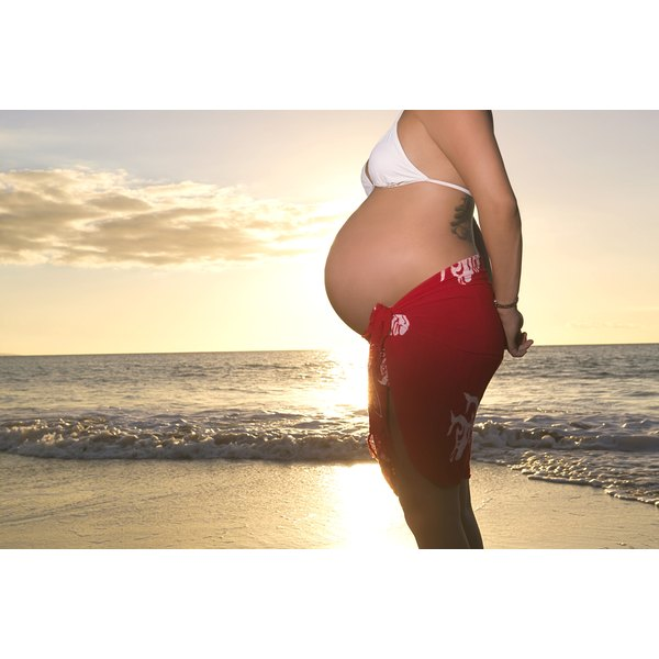Walking on a beach is a great way to tone your legs during pregnancy.