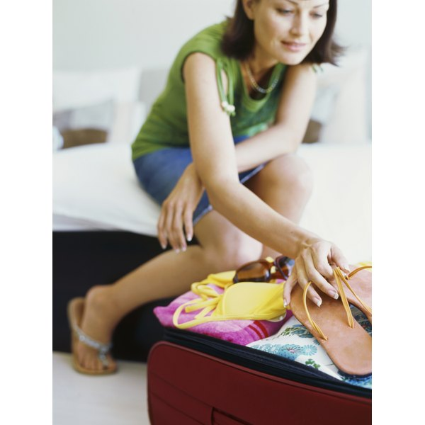 Keep a cocktail dress clean and unwrinkled in your suitcase with some simple preparation before a long trip.