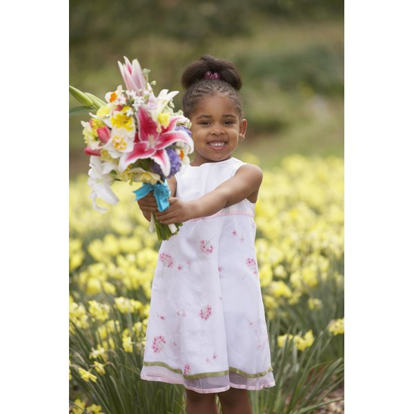 Children can carry flowers in a joyful May Day parade to celebrate spring.