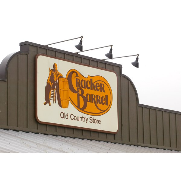 Close-up of a Cracker Barrel sign on the outside of a restaurant.