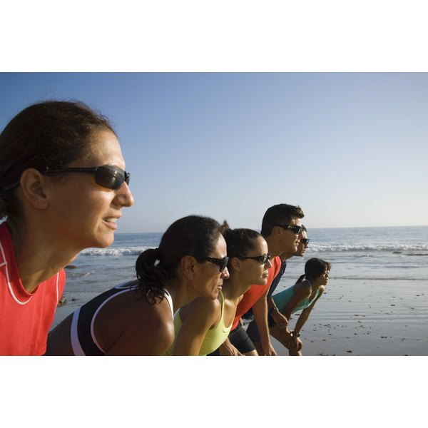 A fitness group getting ready to run along the beach.