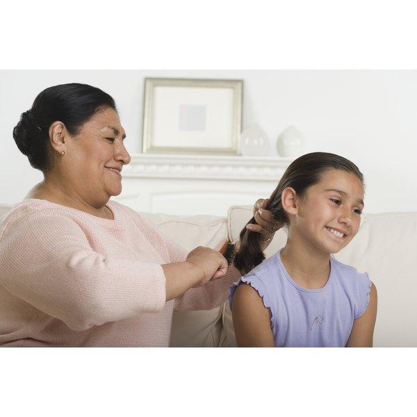 Mom combing a girl's hair