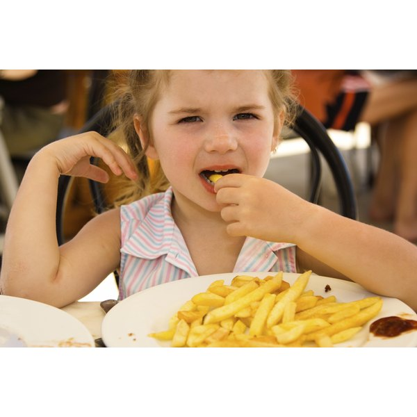 A Little Girl Eating French Fries
